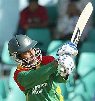 Mohammad Ashraful hooks a six to reach his 50. Bangladesh vs. Kenya, ODI-1, August 12, 2006