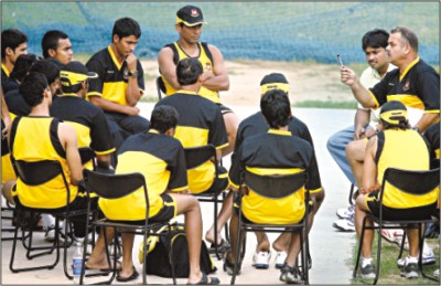 Coach Dav Whatmore passes on a few tips to his players during a training session at the Punjab Cricket Association Stadium, on the eve of their Champions Trophy match against Sri Lanka, in Mohali. © DS