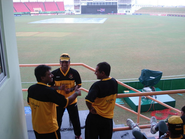 Chief Selector Faruque Ahmed (L) chatting with Javed Omer (C) and Habibul Bashar at the Guyana National Stadium as rain continues to fall. � TigerCricket.com