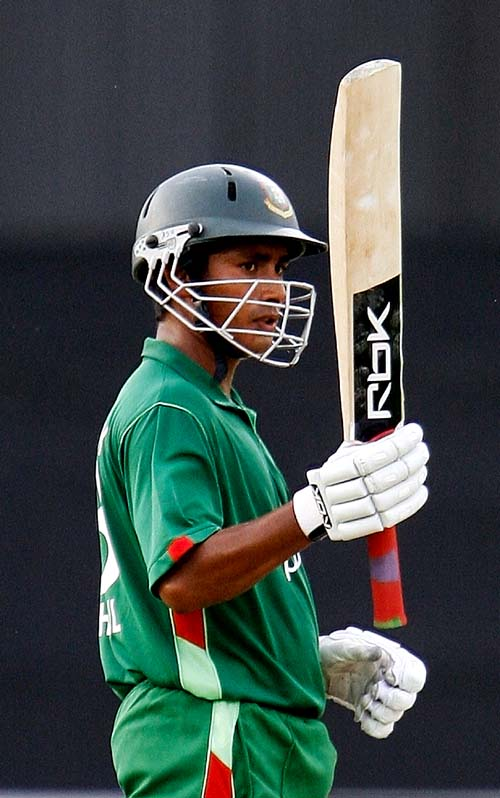 Bangladesh captain Mohammad Ashraful acknowledges his century against the UAE at the Asia Cup match at Lahore